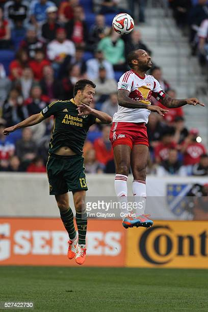 Thierry Henry New York Red Bulls wins a header while challenged by Jack Jewsbury Portland Timbers during the New York Red Bulls Vs Portland Timbers...