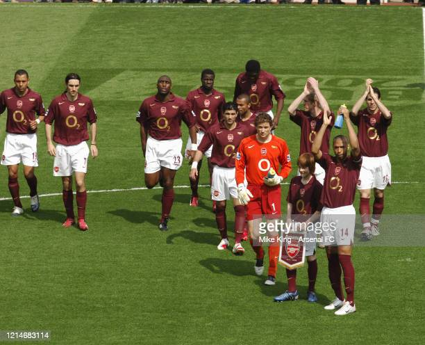 Thierry Henry of Arsenal and the Arsenal team clap the fans before the Premier League match between Arsenal and Wigan Athletic the last match to be...