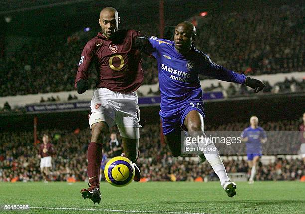 Thierry Henry of Arsenal and William Gallas of Chelsea battle for the ball during the Barclays Premiership match between Arsenal and Chelsea at...