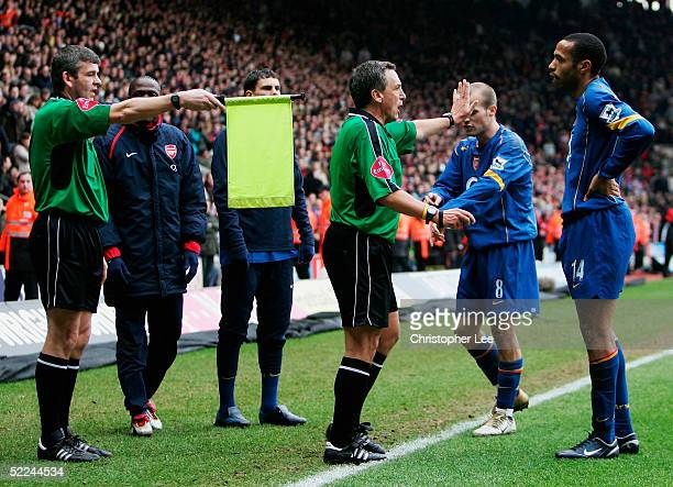 Thierry Henry of Arsenal appeals to the referee Alan Wiley after their last minute goal is dissallowed during the Barclays Premiership match between...