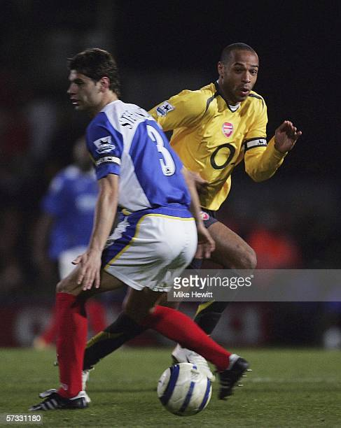 Thierry Henry of Arsenal bamboozles Dejan Stefanovic of Portsmouth during the Barclays Premiership match between Portsmouth and Arsenal at Fratton...