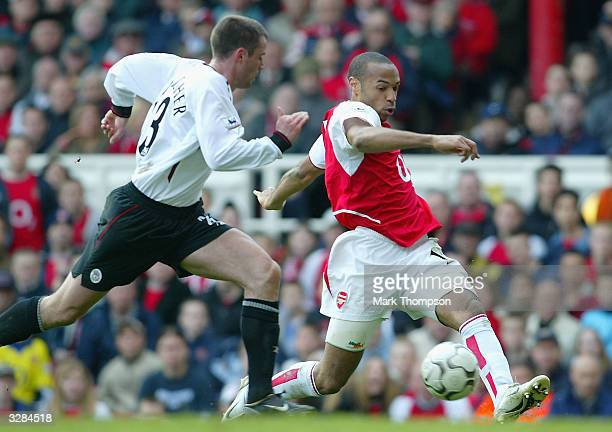 Thierry Henry of Arsenal battles for the ball with Jamie Carragher of Liverpool during the FA Barclaycard Premiership match between Arsenal and...