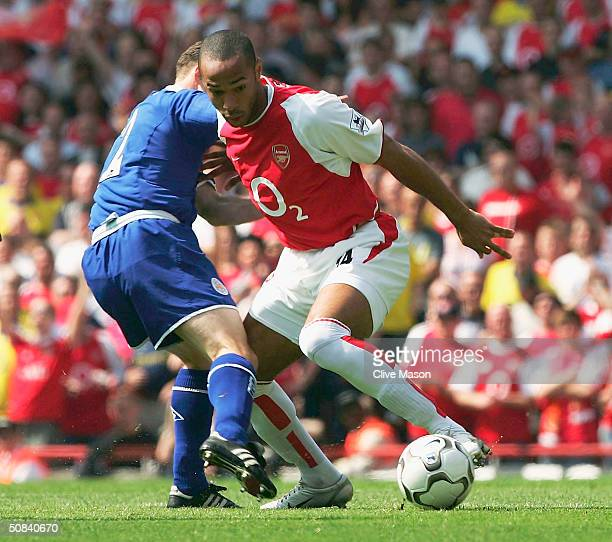 Thierry Henry of Arsenal battles with Paul Dickov of Leicester City during the FA Barclaycard Premiership match between Arsenal and Leicester City at...
