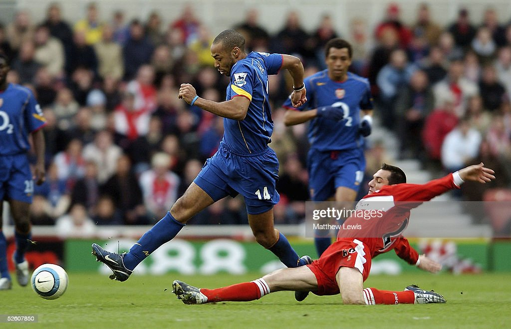 Thierry Henry of Arsenal beats Doriva of Middlesbrough during the Barclays Premiership match between Middlesbrough and Arsenal at the Riverside Stadium on April 9, 2005 in Middlesbrough, England.