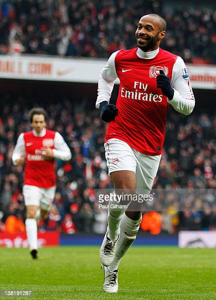 Thierry Henry of Arsenal celebrates after scoring Arsenal's seventh goal of the match during the Barclays Premier League match between Arsenal and...