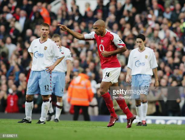 Thierry Henry of Arsenal celebrates during the Barclays Premiership match between Arsenal and Aston Villa on October 16 2004 at Highbury in London...