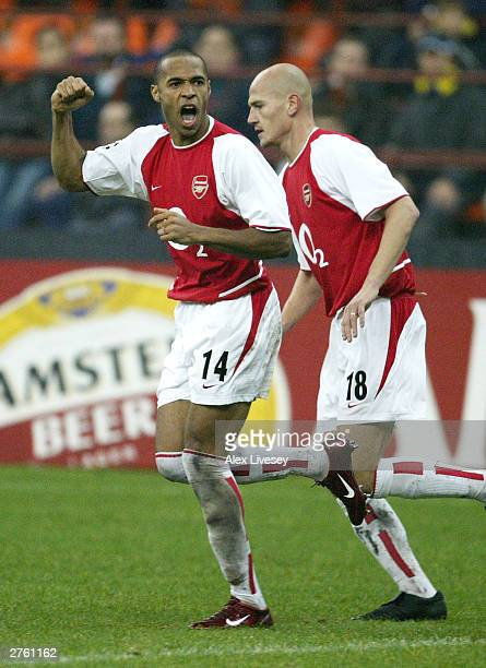 Thierry Henry of Arsenal celebrates Frederic Ljungberg's goal for Arsenal during the UEFA Champions League Group B match between Inter Milan and...