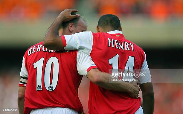 Thierry Henry of Arsenal celebrates scoring against Ajax with teammate Dennis Bergkamp during a pre season 'Dennis Bergkamp' testimonial match at...