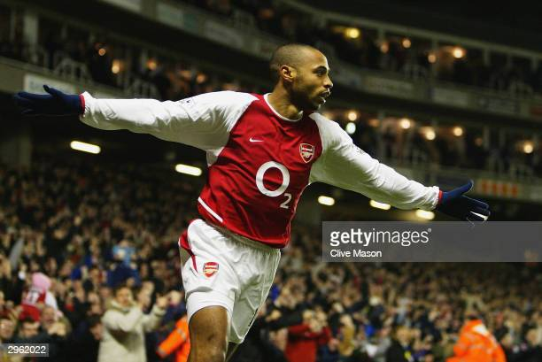 Thierry Henry of Arsenal celebrates scoring his 100th Premiership goal and Arsenal's first goal during the FA Barclaycard Premiership match between...