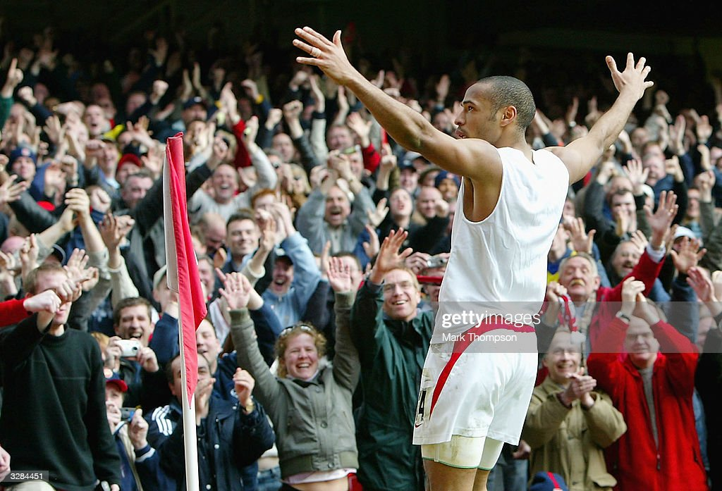 Thierry Henry of Arsenal celebrates scoring his hat-trick and Arsenal's fourth goal during the FA Barclaycard Premiership match between Arsenal and Liverpool at Highbury on April 9, 2004 in London.