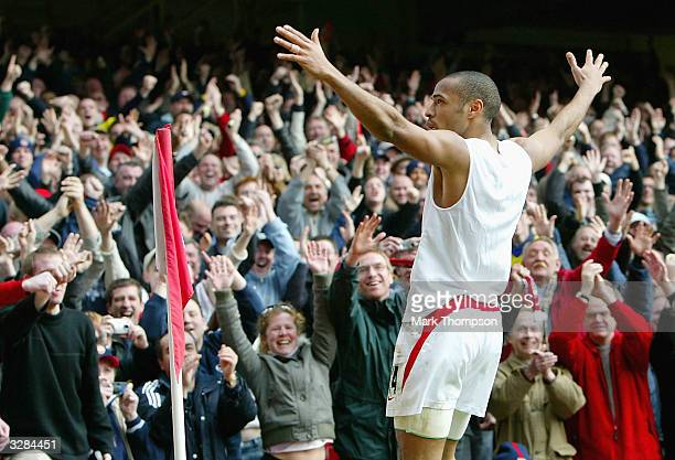 Thierry Henry of Arsenal celebrates scoring his hattrick and Arsenal's fourth goal during the FA Barclaycard Premiership match between Arsenal and...