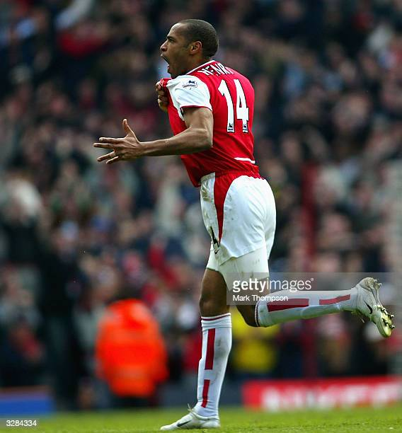 Thierry Henry of Arsenal celebrates scoring the third goal for Arsenal during the FA Barclaycard Premiership match between Arsenal and Liverpool at...
