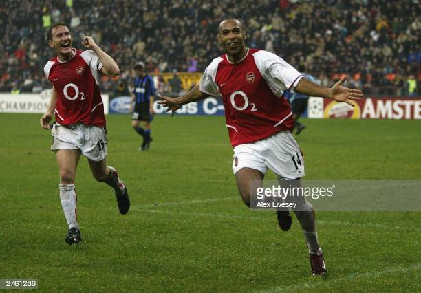 Thierry Henry of Arsenal celebrates scoring their third goal during the UEFA Champions League Group B match between Inter Milan and Arsenal at the...