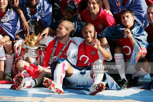 Thierry Henry of Arsenal celebrates winning the Premiership during the FA Barclaycard Premiership match between Arsenal and Leicester City at...