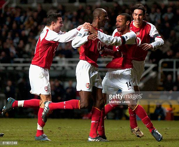 Thierry Henry of Arsenal congratulates Patrick Vieira on his goal during the FA Barclays Premiership match between Newcastle United and Arsenal at...
