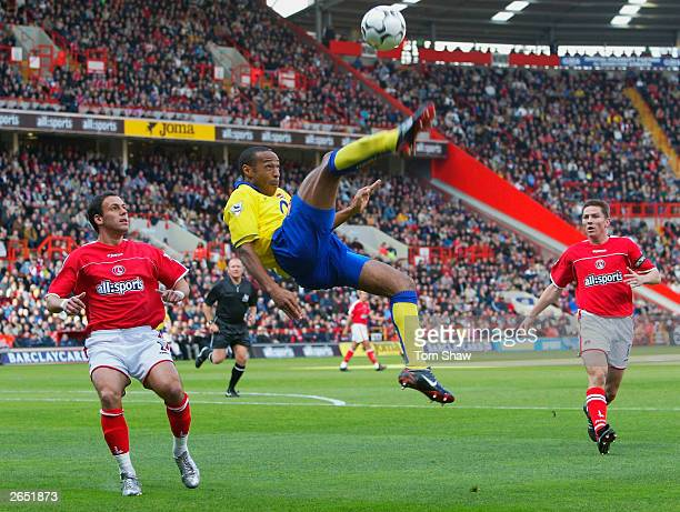 Thierry Henry of Arsenal does an overhead kick to cross the ball past Radostin Kishishev of Charlton Athletic during the FA Barclaycard Premiership...