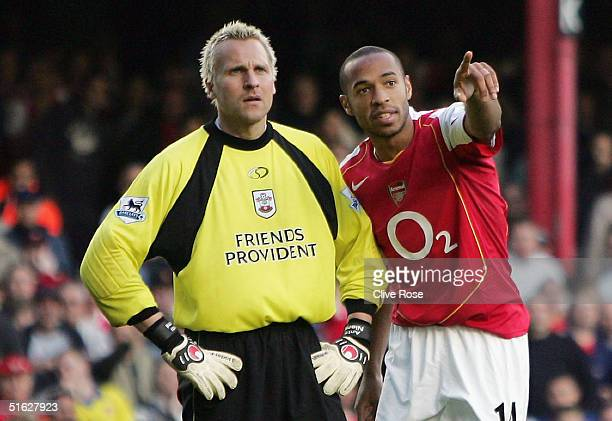 Thierry Henry of Arsenal explains the offside to Antti Niemi of Southampton during the Barclays Premiership match between Arsenal and Southampton at...
