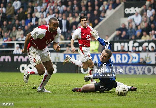 Thierry Henry of Arsenal gets past Shay Given of Newcastle during the FA Barclaycard Premiership match between Newcastle United and Arsenal at St...