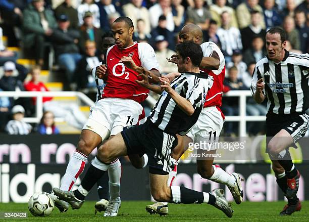 Thierry Henry of Arsenal holds off Aaron Hughes of Newcastleduring the FA Barclaycard Premiership match between Newcastle United and Arsenal at St...