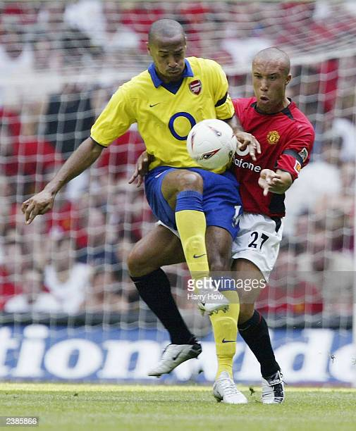 Thierry Henry of Arsenal holds off Mikael Silvestre of Manchester United during the FA Community Shield match between Arsenal and Manchester United...