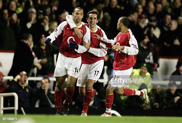 Thierry Henry of Arsenal is congratulated by team mates after scoring the third goal of the game during the Barclays Premiership match between...