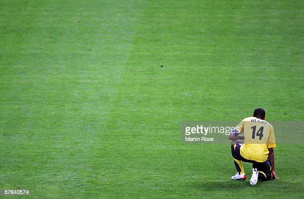 Thierry Henry of Arsenal is despondent after defeat in the UEFA Champions League Final between Arsenal and Barcelona at the Stade de France on May 17...