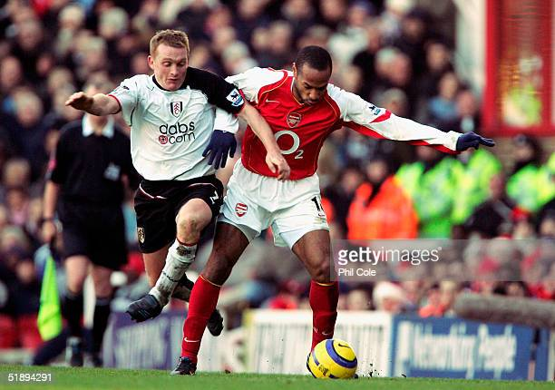 Thierry Henry of Arsenal is tackled by Mark Pembridge of Fulham during the Barclays Premiership match between Arsenal and Fulham at Highbury on...