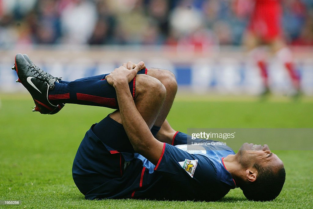 Thierry Henry of Arsenal laying on the grass injured during the FA Barclaycard Premiership match between Middlesbrough and Arsenal held on April 19, 2003 at The Riverside Stadium in Middlesbrough, England. Arsenal won the match 2-0.
