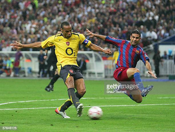 Thierry Henry of Arsenal misses a chance as Rafael Marquez of Barcelona challenges during the UEFA Champions League Final between Arsenal and...