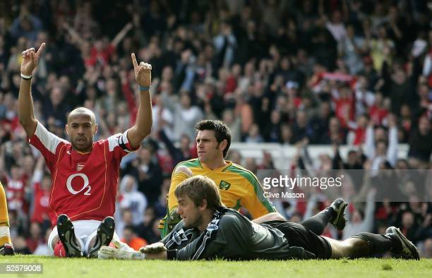 Thierry Henry of Arsenal points to the sky after scoing a hattrick as the Norwich defence look on dejected during the Barclays Premiership match...