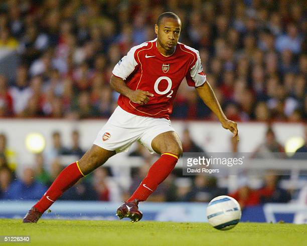 Thierry Henry of Arsenal runs with the ball during the Barclays Premiership match between Arsenal and Blackburn Rovers at Highbury on August 25, 2004...