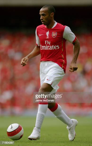 Thierry Henry of Arsenal runs with the ball during the Dennis Bergkamp testimonial match between Arsenal and Ajax at the Emirates Stadium on July 22...