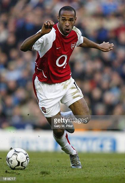 Thierry Henry of Arsenal runs with the ball during the FA Barclaycard Premiership match between Manchester City and Arsenal held on February 22 2003...