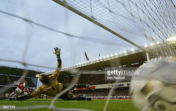 Thierry Henry of Arsenal scores the first goal for Arsenal from the penalty spot during the FA Barclaycard Premiership match between Arsenal and...