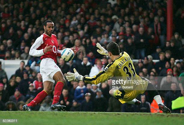 Thierry Henry of Arsenal shoots past Kostas Chalkias of Portsmouth to score during the Barclays Premiership match between Arsenal and Portsmouth at...