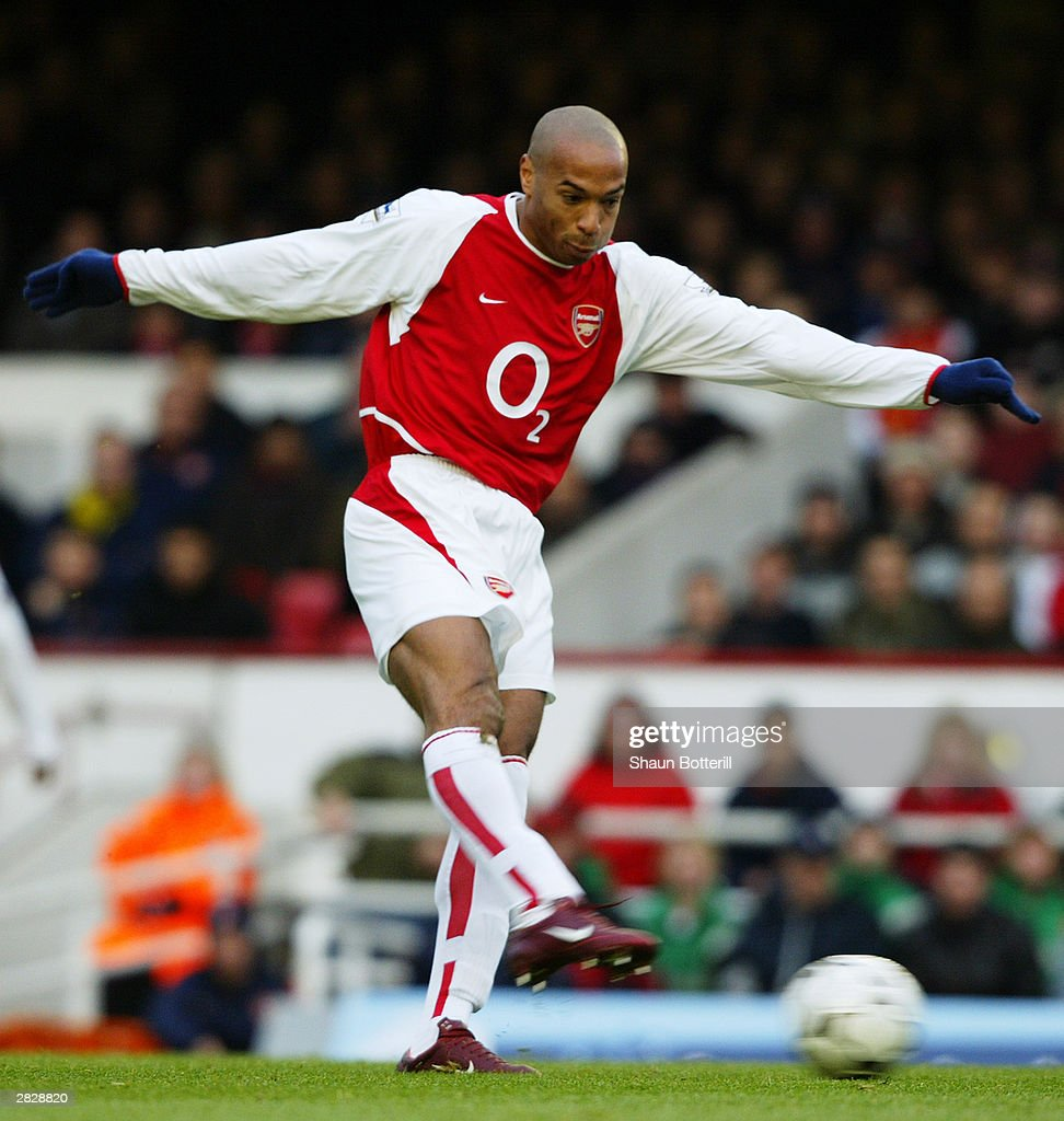 Thierry Henry of Arsenal strikes the ball : News Photo