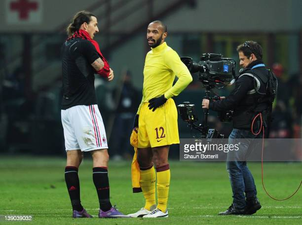 Thierry Henry of Arsenal swaps shirts with Zlatan Ibrahimovic of AC Milan during the UEFA Champions League round of 16 first leg match between AC...