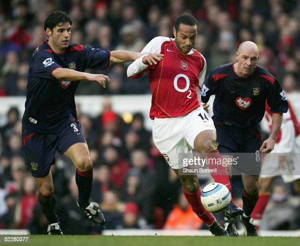 Thierry Henry of Arsenal takes on Dejan Stefanovic of Portsmouth during the Barclays Premiership match between Arsenal and Portsmouth at Highbury on...
