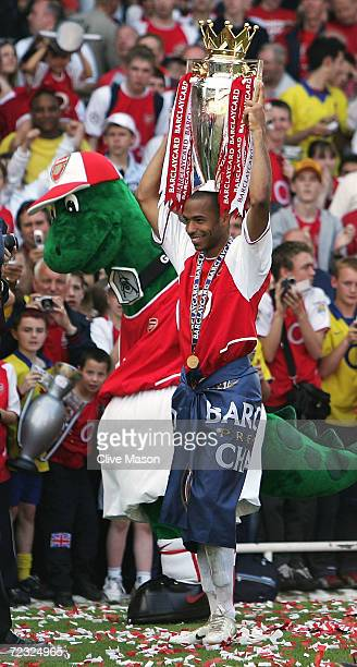 Thierry Henry of Arsenal walks around the ground with the trophy on his head as he celebrates winning the Premiership during the FA Barclaycard...