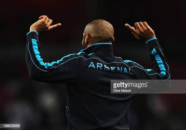 Thierry Henry of Arsenal warms up before the FA Cup Third Round match between Arsenal and Leeds United at the Emirates Stadium on January 9, 2012 in...