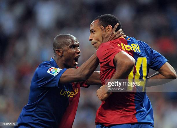 Thierry Henry of Barcelona celebrates with Samuel Eto'o after scoring Barcelona's fourth goal during the La Liga match between Real Madrid and...