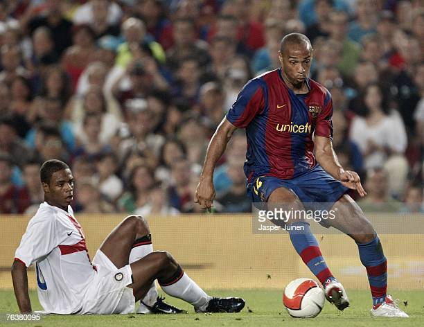 Thierry Henry of Barcelona controls the ball next to Pele of Inter Milan during the Gamper Trophy match between Barcelona and Inter Milan at the Nou...