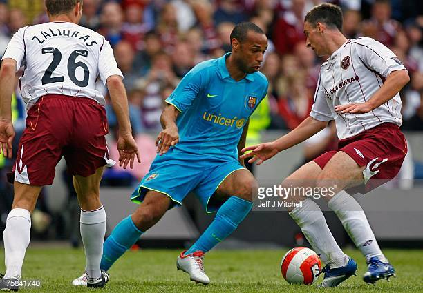 Thierry Henry of Barcelona evades the Hearts defence during their friendly match between Hearts and Barcelona at Murrayfield Stadium on July 28 2007...