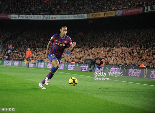 Thierry Henry of Barcelona in action during the La Liga match between Barcelona and Espanyol at the Camp Nou stadium Stadium on December 12 2009 in...