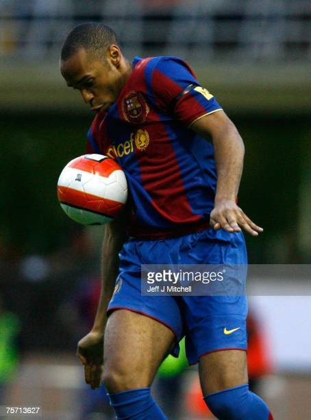 Thierry Henry of Barcelona in action during their friendly match between Dundee United and Barcelona at Tannadice Stadium on July 26 2007 in Dundee...