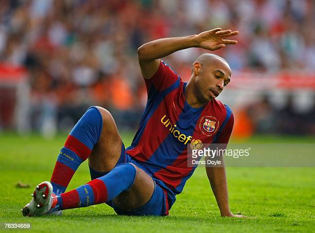 Thierry Henry of Barcelona reacts after missing a shot at goal during the Primera Liga match between Racing Santander and Barcelona at the El...