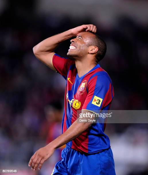 Thierry Henry of Barcelona reacts after missing a shot at goal during the La Liga match between UD Almeria and Barcelona at the Estadio de los Juegos...