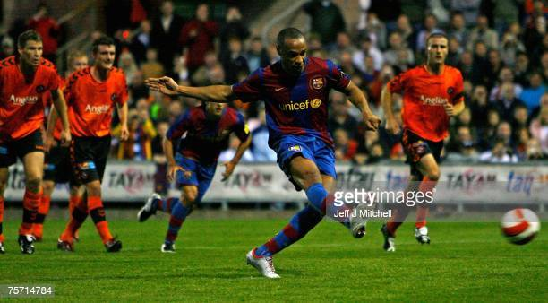 Thierry Henry of Barcelona takes a penalty during their friendly match between Dundee United and Barcelona at Tannadice Stadium on July 26 2007 in...