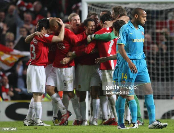 Thierry Henry of Barcelona walks past the celebrating Manchester United players at the end of the UEFA Champions League Semi Final second leg match...