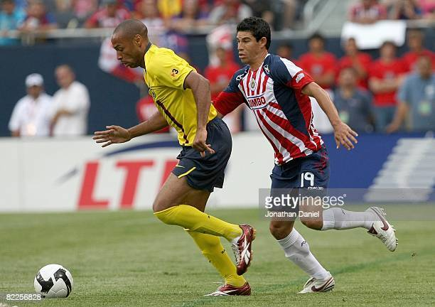 Thierry Henry of FC Balcelona controls the ball against Jhonny Magallon of CD Guadalajara during a international friendly match on August 3, 2008 at...
